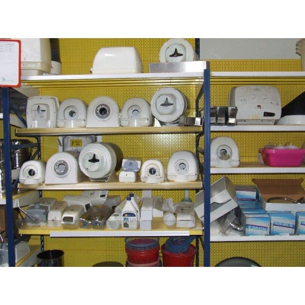 Used paper towels and soap dispenser  Feeders